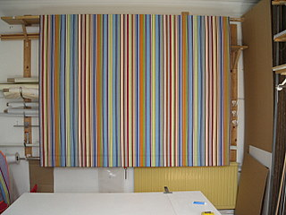 Large blind made in a colourful striped John Lewis fabric