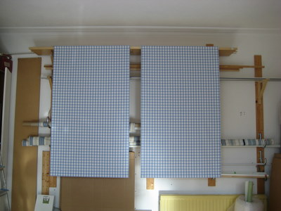 Finished blinds being tested in workshop